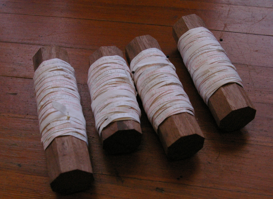 interlacing threads of thought. typed, cut, and wound around walnut spools.